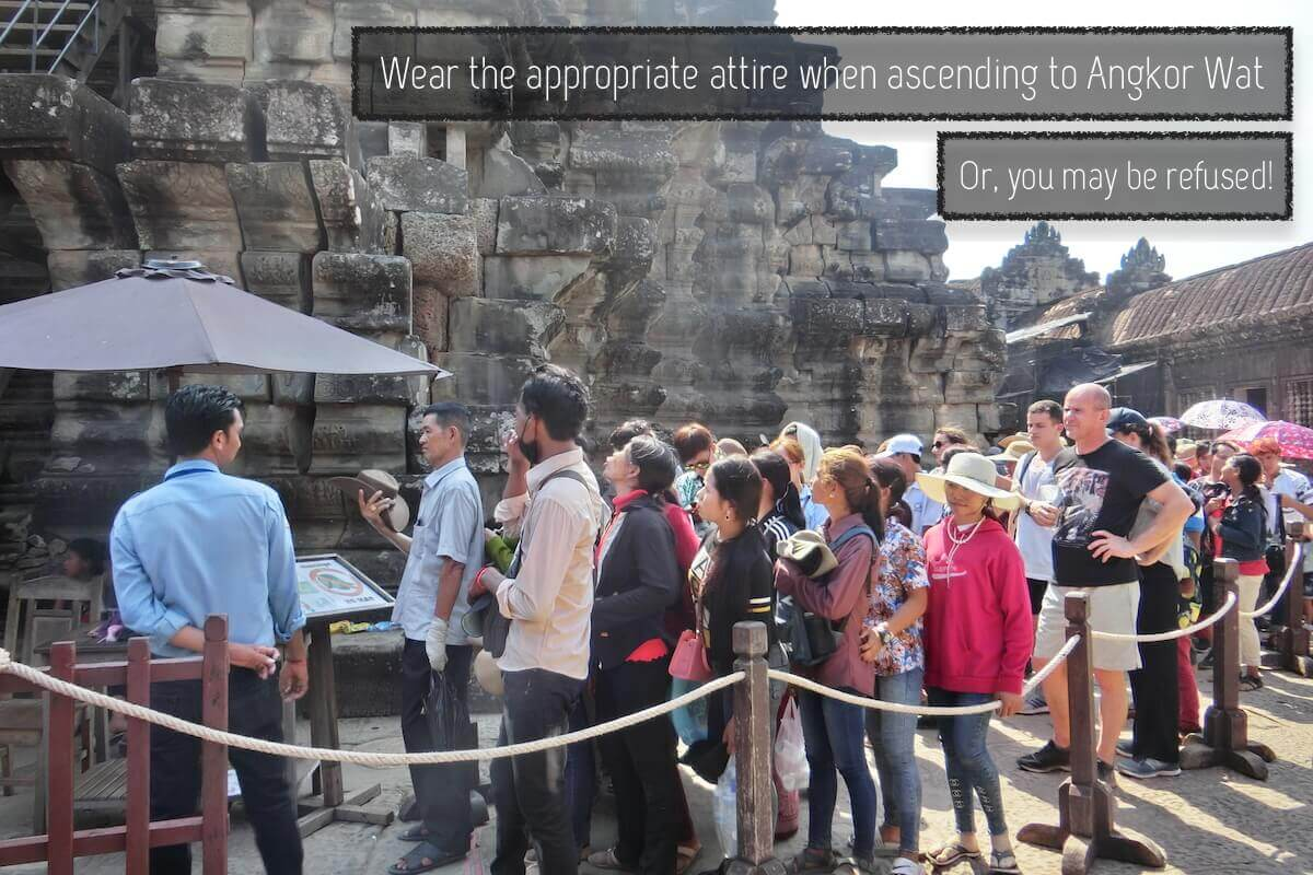 Wear the appropriate attire when ascending to Angkor Wat temple