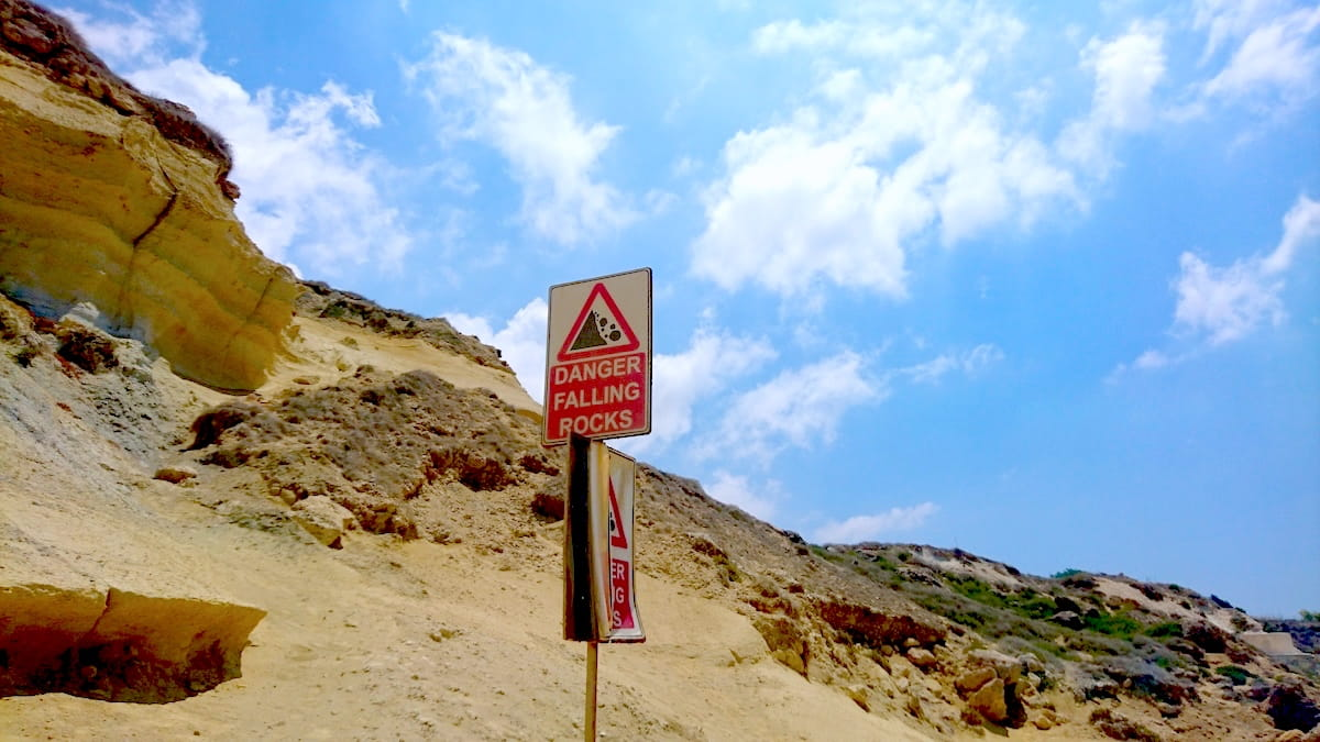 "Gnejha Bay Warning Signboard ""Danger Falling Rocks"""